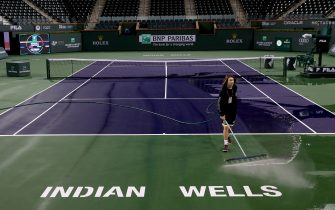 INDIAN WELLS, CALIFORNIA - MARCH 08:  Courtmaster Jeffrey Brooker cleans the center court at the Indian Wells Tennis Garden on March 08, 2020 in Indian Wells, California. The BNP Paribas Open was cancelled by the Riverside County Public Health Department, as county officials declared a public health emergency when a case of coronavirus (COVID-19) was confirmed in the area. (Photo by Matthew Stockman/Getty Images)