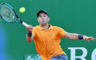 Croatia's Borna Coric hits a return to Italy's Fabio Fognini during their quarter final tennis match at the Monte-Carlo ATP Masters Series tournament on April 19, 2019 in Monaco. (Photo by YANN COATSALIOU / AFP)        (Photo credit should read YANN COATSALIOU/AFP via Getty Images)