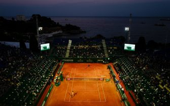 TOPSHOT - Italy's Fabio Fognini (up) returns the ball to Croatia's Borna Coric during their quarter final tennis match on Day 7 of the Monte-Carlo ATP Masters Series tournament on April 19, 2019 in Monaco. (Photo by VALERY HACHE / AFP)        (Photo credit should read VALERY HACHE/AFP via Getty Images)