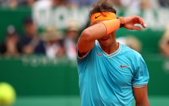 MONTE-CARLO, MONACO - APRIL 20: Rafael Nadal of Spain shows his dejection during his straight sets defeat by Fabio Fognini of Italy in their semifinal match during day seven of the Rolex Monte-Carlo Masters at Monte-Carlo Country Club on April 20, 2019 in Monte-Carlo, Monaco. (Photo by Clive Brunskill/Getty Images)
