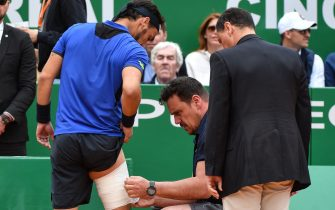 Italy's Fabio Fognini receives treatment from a trainer between games against Serbia's Dusan Lajovic during the final tennis match of the Monte-Carlo ATP Masters Series tournament in Monaco on April 21, 2019. (Photo by Yann COATSALIOU / AFP)        (Photo credit should read YANN COATSALIOU/AFP via Getty Images)