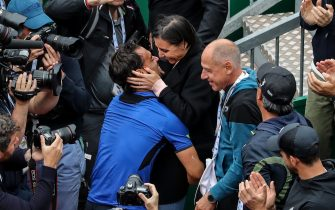 Italy's Fabio Fognini (L) kisses his wife Flavia Pennetta as he celebrates his victory over Serbia's Dusan Lajovic at the end of the final tennis match of the Monte-Carlo ATP Masters Series tournament in Monaco on April 21, 2019. (Photo by VALERY HACHE / AFP)        (Photo credit should read VALERY HACHE/AFP via Getty Images)