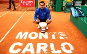MONTE-CARLO, MONACO - APRIL 21:  Fabio Fognini of Italy poses for a photograph with his winners trophy and the Monte Carlo court logo after his straight sets victory against Dusan Lajovic of Serbia in the men's singles final during day eight of the Rolex Monte-Carlo Masters at Monte-Carlo Country Club on April 21, 2019 in Monte-Carlo, Monaco. (Photo by Clive Brunskill/Getty Images)