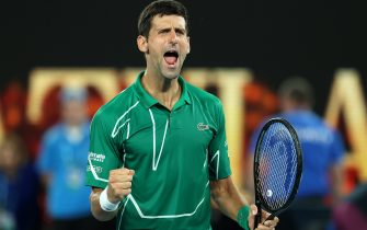 MELBOURNE, AUSTRALIA - JANUARY 30: Novak Djokovic of Serbia celebrates after winning his Men's Singles Semifinal match against Roger Federer of Switzerland on day eleven of the 2020 Australian Open at Melbourne Park on January 30, 2020 in Melbourne, Australia. (Photo by Clive Brunskill/Getty Images)