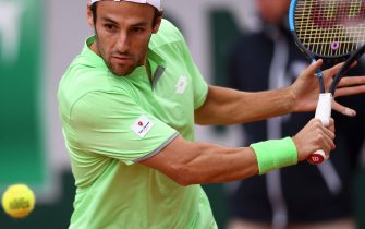 Italy's Stefano Travaglia eyes the ball as he plays a forehand return to France's Adrian Mannarino during their men's singles first round match on day three of The Roland Garros 2019 French Open tennis tournament in Paris on May 28, 2019. (Photo by Anne-Christine POUJOULAT / AFP)        (Photo credit should read ANNE-CHRISTINE POUJOULAT/AFP via Getty Images)