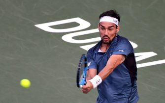 Italy's Fabio Fognini returns the ball to Britain's Daniel Evans during the of the Dubai Duty Free Tennis Championships in the United Arab Emirates on February 25, 2020. (Photo by KARIM SAHIB / AFP) (Photo by KARIM SAHIB/AFP via Getty Images)
