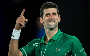 MELBOURNE, AUSTRALIA - JANUARY 30: Novak Djokovic of Serbia celebrates his victory in his semi final match against Roger Federer of Switzerland on day eleven of the 2020 Australian Open at Melbourne Park on January 30, 2020 in Melbourne, Australia. (Photo by Chaz Niell/Getty Images)