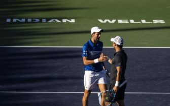 INDIAN WELLS, CALIFORNIA - MARCH 08: Novak Djokovic of Serbia and Fabio Fognini of Italy in action in the first round of the  men's doubles against Milos Raonic of Canada and Jeremy Chardy of France on March 08, 2019 at the Indian Wells Tennis Garden in Indian Wells, California. (Photo by TPN/Getty Images)