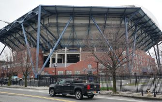The US Army Corps is planning to build a temporary hospital to cope with coronavirus cases at the Arthur Ashe Stadium at the USTA Billie Jean King National Tennis Center in the Borough of Queens on March 31, 2020 in New York. (Photo by Bryan R. Smith / AFP) (Photo by BRYAN R. SMITH/AFP via Getty Images)