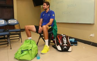 MANILA, PHILIPPINES - NOVEMBER 29:  Marin Cilic of the UAE Royals sits in the locker room ready for his match against Tomas Berdych of the Singapore Slammers during the Coca-Cola International Premier Tennis League at the Mall of Asia Arena on November 29, 2014 in Manila, Philippines.  (Photo by Clive Brunskill/Getty Images for IPTL 2014)