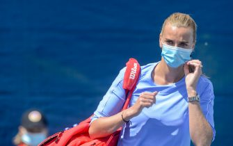 Czech tennis player Petra Kvitova wears a face mask as she arrives to play a match of the Czech Tennis Association (CTS) President's Cup on May 26, 2020  in Prague. - The Czech Tennis Association (CTS) is holding a spectatorless charity tournament to raise funds to help those affected by the coronavirus crisis in the Czech Republic, with the first round set for May 26-28 at the Sparta Prague tennis club. (Photo by Michal Cizek / AFP) (Photo by MICHAL CIZEK/AFP via Getty Images)
