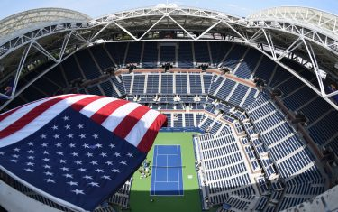 The US flag flies over Arthur Ashe Stadium August 27, 2017 at the National Tennis Center in New York. Tournament play in the 2017 US Open is set to begin August 28, 2017. (Photo by Jewel SAMAD / AFP) (Photo by JEWEL SAMAD/AFP via Getty Images)