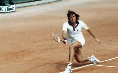 Italian tennis player Adriano Panatta prepares a forehand in his match against Mexican Raul Ramirez in june 1977 during the French Open at Roland Garros stadium. (Photo by - / AFP) (Photo by -/AFP via Getty Images)