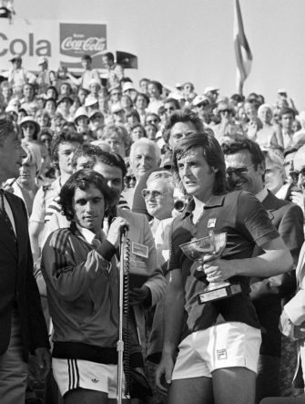Italian Adriano Panatta (R) holds up her trophy after defeating US Harold Solomon at Roland Garros stadium during the French tennis Open, on June 13, 1976. It was Barker's 1st (and only) career Grand Slam title.   AFP PHOTO (Photo credit should read STAFF/AFP via Getty Images)