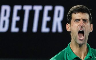 epa08188462 Novak Djokovic of Serbia celebrates during the men's singles final against Dominic Thiem of Austria on day 14 of the Australian Open tennis tournament at Rod Laver Arena in Melbourne, Sunday, February 2, 2020.  EPA/SCOTT BARBOUR AUSTRALIA AND NEW ZEALAND OUT