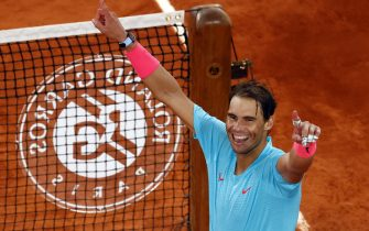 epa08736144 Rafael Nadal of Spain reacts after winning against Novak Djokovic of Serbia in their menâ  s final match during the French Open tennis tournament at Roland â  Garros in Paris, France, 11 October 2020.  EPA/IAN LANGSDON