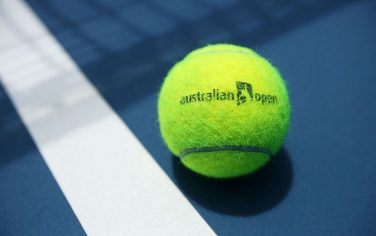 MELBOURNE, AUSTRALIA - JANUARY 11:  An Australian Open branded tennis ball is seen on court ahead of the 2015 Australian Open at Melbourne Park on January 11, 2015 in Melbourne, Australia.  (Photo by Graham Denholm/Getty Images)
