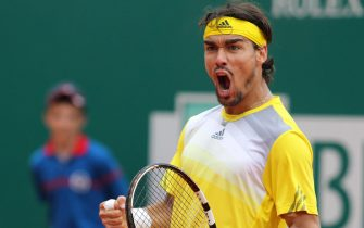 epa03668798 Fabio Fognini of Italy celebrates after beating Richard Gasquet of France during his quarter final match at the Monte Carlo Rolex Masters tournament in Roquebrune Cap Martin, France, 19 April 2013.  EPA/SEBASTIEN NOGIER