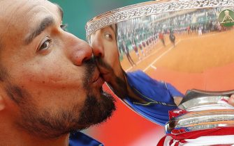 epaselect epa07520136 Fabio Fognini of Italy poses with his trophy after winning against Dusan Lajovic of Serbia in their final match of the Monte-Carlo Rolex Masters tournament in Roquebrune Cap Martin, France, 21 April 2019.  EPA/SEBASTIEN NOGIER