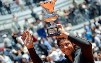 Spanish tennis player Rafael Nadal poses with the winner's trophy after beating serbian Novak Djokovic in their final match of the Italian Open tennis tournament  (ATP World Tour) in the Central Stadium at the Foro Italico in Rome, Italy, 21 May 2012. Nadal won 7-5, 6-3. ANSA/CLAUDIO ONORATI