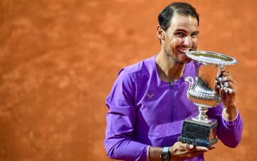 Spain's Rafael Nadal bites the winner's trophy after defeating Serbia's Novak Djokovic during the final of the Men's Italian Tennis Open at Foro Italico on May 16, 2021 in Rome, Italy. (Photo by Filippo MONTEFORTE / AFP) (Photo by FILIPPO MONTEFORTE/AFP via Getty Images)