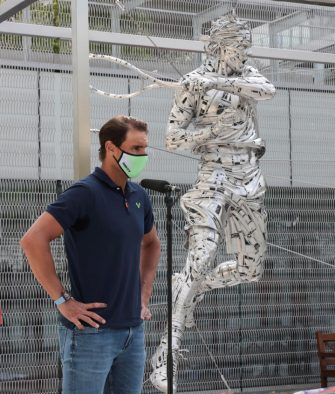 epa09231669 A handout photo made available by Gabinete de Jordi Diez shows Spanish tennis player Rafa Nadal posing for the media during the presentation of his steel statue made by Spanish artist Jordi Diez as a tribute for his trajectory in the Roland Garros tennis tournament, in Paris, France, 27 May 2021.  EPA/Xavi Pladellorens / Gabinete de Jordi Diez / HANDOUT HANDOUT TO BE USED SOLELY TO ILLUSTRATE THE NEWS DEPICTED IN THIS IMAGE / MANDATORY CREDIT / HANDOUT EDITORIAL USE ONLY/NO SALES