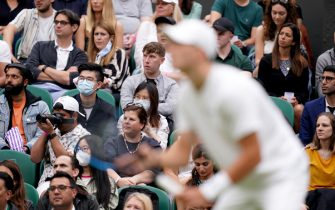 Fans watch the action Centre Court on day one of Wimbledon at The All England Lawn Tennis and Croquet Club, Wimbledon. Picture date: Monday June 28, 2021.