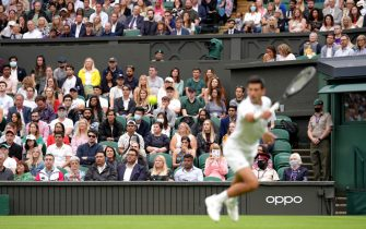Fans watch Novak Djokovic in action against Jack Draper on centre court on day one of Wimbledon at The All England Lawn Tennis and Croquet Club, Wimbledon. Picture date: Monday June 28, 2021.
