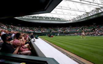 Spectators applaud as Aryna Sabalenka wins the first game during her singles match against Monica Niculescu on court one on day one of Wimbledon at The All England Lawn Tennis and Croquet Club, Wimbledon. Picture date: Monday June 28, 2021.
