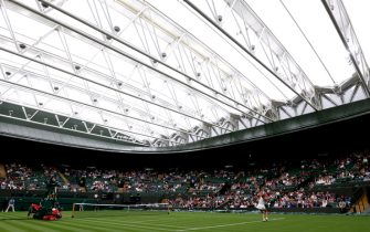 Aryna Sabalenka serves the first ball of the tournament during her singles match against Monica Niculescu on court one on day one of Wimbledon at The All England Lawn Tennis and Croquet Club, Wimbledon. Picture date: Monday June 28, 2021.