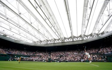 Jack Draper serves to Novak Djokovic on centre court on day one of Wimbledon at The All England Lawn Tennis and Croquet Club, Wimbledon. Picture date: Monday June 28, 2021.