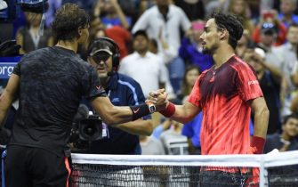epa04914016 Fabio Fognini of Italy (R) and Rafael Nadal of Spain (L) shake hands at the net after Fognini defeated Nadal in  their match on the fifth day of the 2015 US Open Tennis Championship at the USTA National Tennis Center in Flushing Meadows, New York, USA, 04 September 2015. The US Open runs through 13 September, which is a return to a 14-day schedule.  EPA/JOHN G. MABANGLO