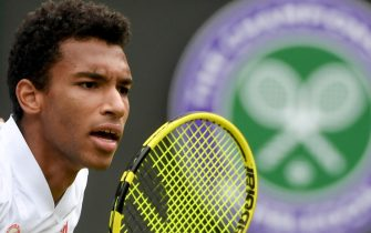 epa09329176 Felix Auger-Aliassime of Canada serves during the men's quarter final match against Matteo Berrettini of Italy at the Wimbledon Championships, in Wimbledon, Britain, 07 July 2021.  EPA/FACUNDO ARRIZABALAGA   EDITORIAL USE ONLY