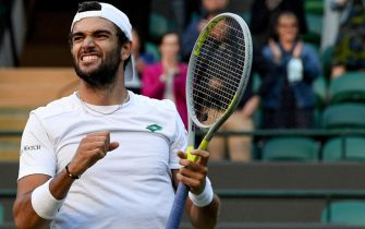epa09329848 Matteo Berrettini of Italy reacts after winning the men's quarter final match against Felix Auger-Aliassime of Canada at the Wimbledon Championships, in Wimbledon, Britain, 07 July 2021.  EPA/FACUNDO ARRIZABALAGA   EDITORIAL USE ONLY