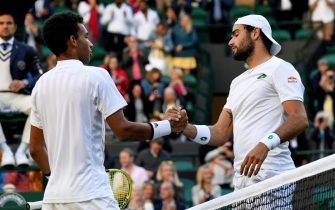 epa09329853 Matteo Berrettini of Italy (R) reacts after winning the men's quarter final match against Felix Auger-Aliassime of Canada (L) at the Wimbledon Championships, in Wimbledon, Britain, 07 July 2021.  EPA/FACUNDO ARRIZABALAGA   EDITORIAL USE ONLY