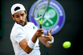 epa09329628 Matteo Berrettini of Italy hits a forehand during the men's quarter final match against Felix Auger-Aliassime of Canada at the Wimbledon Championships, in Wimbledon, Britain, 07 July 2021.  EPA/FACUNDO ARRIZABALAGA   EDITORIAL USE ONLY