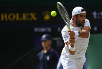 epa09337410 Matteo Berrettini of Italy in action against Novak Djokovic of Serbia during the men's final at the Wimbledon Championships, Wimbledon, Britain 11 July 2021.  EPA/NEIL HALL   EDITORIAL USE ONLY