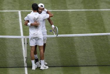epa09337749 Novak Djokovic of Serbia shakes hands with Matteo Berrettini of Italy after winning the men's final at the Wimbledon Championships, Wimbledon, Britain 11 July 2021.  EPA/Peter Nicholls / POOL   EDITORIAL USE ONLY