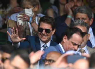 epa09337120 US actor Tom Cruise arrives for the Men's final match Novak Djokovic of Serbia against Matteo Berrettini of Italy at the Wimbledon Championships tennis tournament in Wimbledon, Britain 11 July 2021.  EPA/NEIL HALL   EDITORIAL USE ONLY