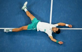 epa09027489 Novak Djokovic of Serbia celebrates after winning his Men's singles finals match against Daniil Medvedev of Russia on Day 14 of the Australian Open Grand Slam tennis tournament at Melbourne Park in Melbourne, Australia, 21 February 2021.  EPA/JAMES ROSS AUSTRALIA AND NEW ZEALAND OUT