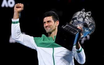 epaselect epa09027405 Novak Djokovic of Serbia lifts the Norman Brooks Challenge Cup after winning his Men's singles finals match against Daniil Medvedev of Russia on Day 14 of the Australian Open Grand Slam tennis tournament at Melbourne Park in Melbourne, Australia, 21 February 2021.  EPA/DAVE HUNT AUSTRALIA AND NEW ZEALAND OUT