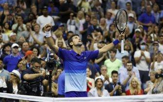 epa09452494 Novak Djokovic of Serbia celebrates after defeating Jenson Brooksby of the US during their match on the eighth day of the US Open Tennis Championships the USTA National Tennis Center in Flushing Meadows, New York, USA, 06 September 2021. The US Open runs from 30 August through 12 September.  EPA/JASON SZENES