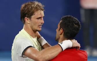 epa09379338 Alexander Zverev (L) of Germany congratulates Novak Djokovic (R) of Serbia after the Men's Singles Semifinal Tennis events of the Tokyo 2020 Olympic Games at the Ariake Coliseum in Tokyo, Japan, 30 July 2021.  EPA/RUNGROJ YONGRIT