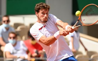 epa09250849 Pablo Carreno Busta of Spain in action against Stefanos Tsitsipas of Greece during their fourth round match at the French Open tennis tournament at Roland Garros in Paris, France, 06 June 2021.  EPA/CAROLINE BLUMBERG