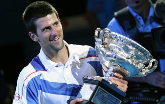 epa02557266 Novak Djokovic of Serbia hold his trophy after winning against Andy Murray of Great Britain during their men's singles final round match at the Australian Open Grand Slam tennis tournament in Melbourne, Australia, 30  January 2011.  EPA/BARBARA WALTON