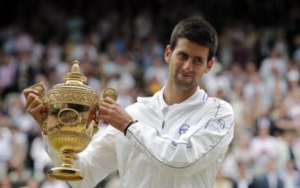 epa02808684 Novak Djokovic of Serbia holds the championship trophy following his victory over Rafael Nadal of Spain in the men's singles final of the Wimbledon Championships at the All England Lawn Tennis Club, in London, Britain, 03 July 2011.  EPA/KERIM OKTEN