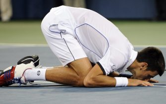 epa02914109 Novak Djokovic of Serbia reacts after defeating Rafael Nadal of Spain in the men's final match on the fifteenth day of the 2011 US Open Tennis Championship at the USTA National Tennis Center in Flushing Meadows, New York, USA 12 September 2011. The men's final is being played on a Monday for the fourth straight year due to weather delays.  EPA/JUSTIN LANE
