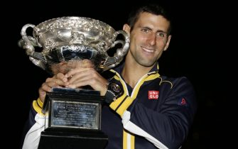 epa03558485 Novak Djokovic of Serbia poses with the trophy during a photocall after winning the men's final against Andy Murray of Great Britain at the Australian Open Grand Slam tennis tournament in Melbourne, Australia, 28 January 2013.  EPA/Dennis Sabangan