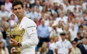 epa04844361 Novak Djokovic of Serbia celebrates with the trophy after winning against Roger Federer of Switzerland during their final match for the Wimbledon Championships at the All England Lawn Tennis Club, in London, Britain, 12 July 2015.  EPA/ANDY RAIN EDITORIAL USE ONLY/NO COMMERCIAL SALES