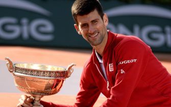 epa05347618 Novak Djokovic of Serbia poses with the trophy after winning against Andy Murray of Britain their men's single final match at the French Open tennis tournament at Roland Garros in Paris, France, 05 June 2016.  EPA/Caroline Blumberg
